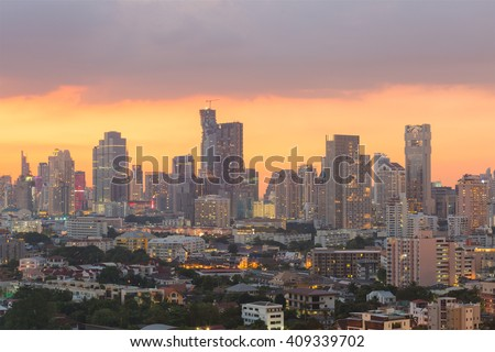 Aerial view of modern office buildings, condominium and hotel  in Bangkok city downtown at sunset  - stock photo