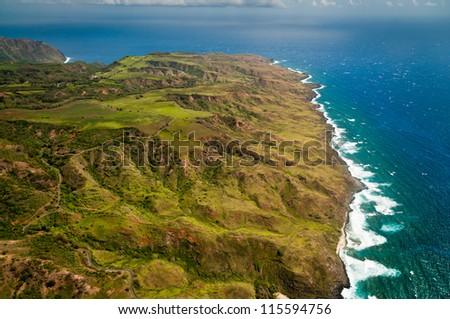 Aerial view of Molokai island coastline and lush hills - stock photo