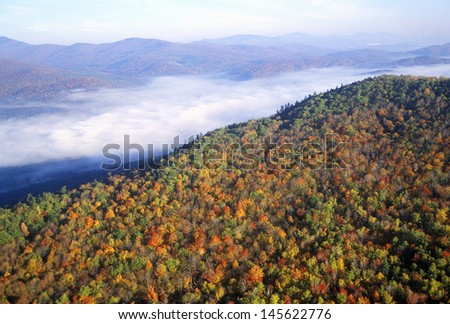 Aerial view of morning fog over mountains near Stowe, VT in autumn along Scenic Route 100 - stock photo