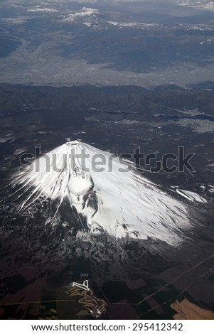 Aerial view of Mount Fuji and Japanese Alps, Japan. Mt. Fuji is the highest mountain in Japan. It was added to the World Heritage in June, 2013. - stock photo