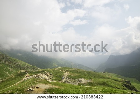 Aerial view of mountain road and village - stock photo