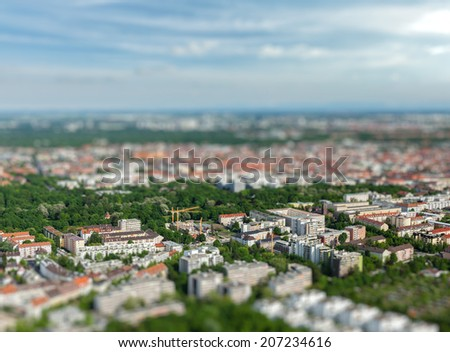 Aerial view of Munich from Olympiaturm (Olympic Tower) with tilt shift toy effect shallow depth of field. Munich, Bavaria, Germany - stock photo