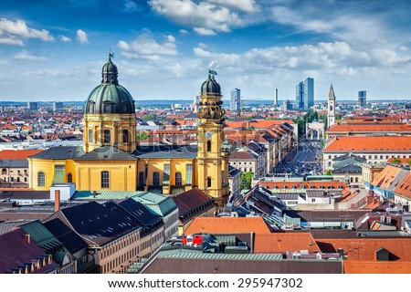 Aerial view of Munich over Theatine Church of St. Cajetan (Theatinerkirche St. Kajetan) and Odeonplatz, Munich, Bavaria, Germany in day time - stock photo