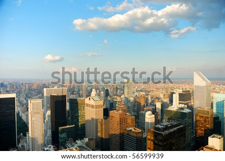 Aerial view of New York City at dusk with warm sunset color and cloud. - stock photo