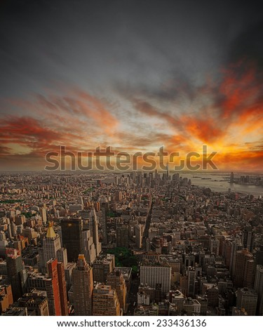 Aerial view of New York City from the Empire State Building at sunset. - stock photo