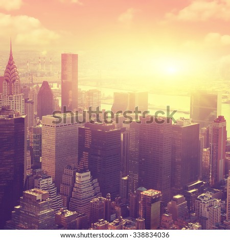 Aerial view of New York City Manhattan  at sunrise. - stock photo