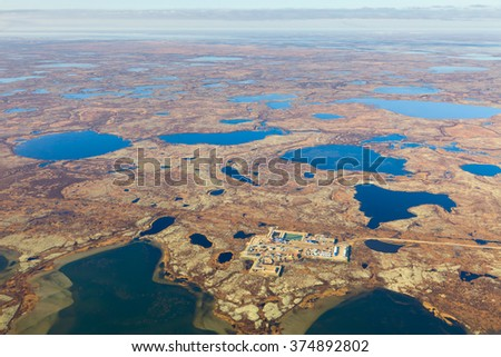 Aerial view of oilfield on impassable tundra area.
