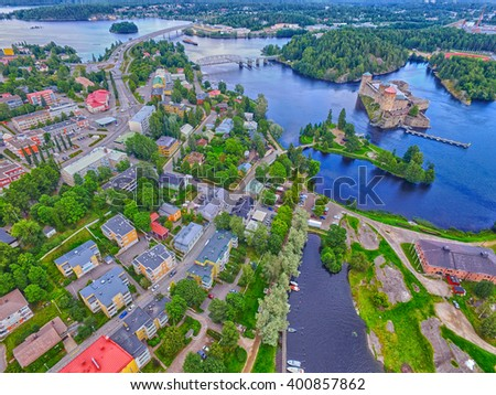 Aerial view of Olavinlinna Olofsborg Medieval 15th century Castle and Savonlinna town in Finland. - stock photo