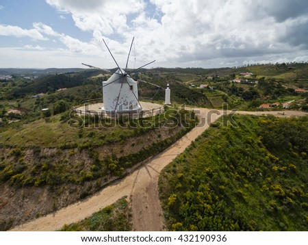 Aerial view of old deserted windmill with Silves town in background, Algarve, Portugal