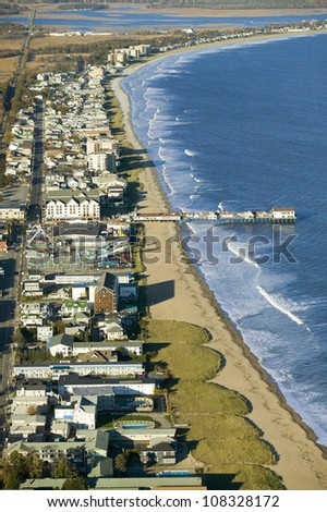 Aerial view of Old Orchard Beach downtown, pier, new hotel and amusement park on Maine Coastline south of Portland - stock photo
