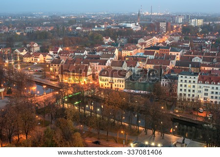 Aerial view of Old Town in Klaipeda, Lithuania in the autumn sunset. Dane river