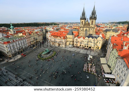 Aerial view of Old Town Square Prague with Gothic Tyn Church on one side and the statue of Jan Hus in the center.   - stock photo