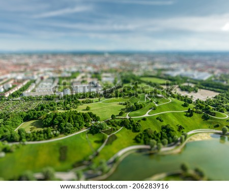 Aerial view of Olympiapark and Munich from Olympiaturm (Olympic Tower) with tilt shift toy effect shallow depth of field. Munich, Bavaria, Germany - stock photo