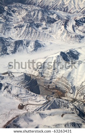 aerial view of open-pit mine under snow in Atacama desert, Chile - stock photo