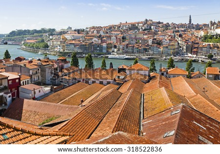 Aerial view of orange tile rooftops in Porto old town, Portugal - stock photo