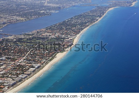 Aerial view of Palm Beach, Florida and the Atlantic Ocean with near shore reefs - stock photo