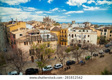 aerial view of Palma de Mallorca with the Cathedral La Seu in the distance - stock photo
