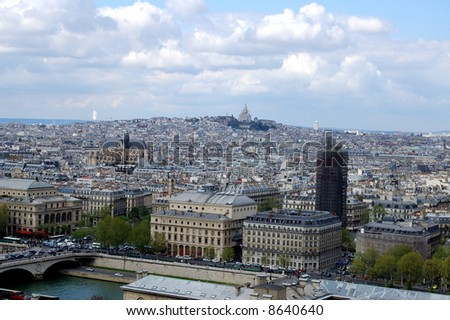 Aerial view of Paris with Sacre-Coeur dominating the horizon - stock photo
