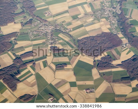 aerial view of patchwork of farms and village in Alsace Lorraine, France - stock photo