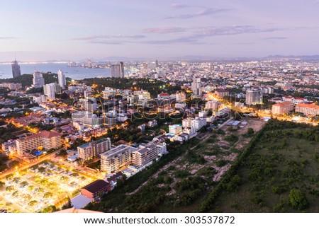 Aerial view of pattaya city at dusk - stock photo