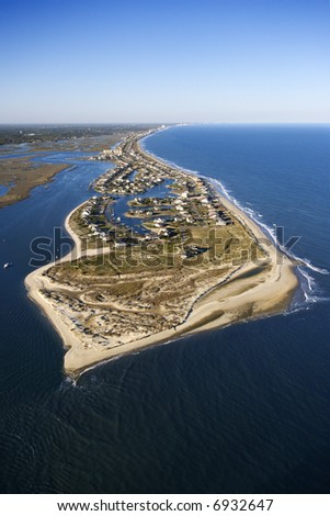 Aerial view of peninsula with beach and buildings in Murrells Inlet, South Carolina.