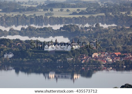 Aerial view of Ploen palace with lake Ploen - stock photo