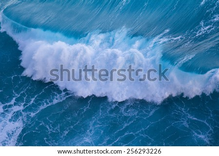 Aerial view of powerful wave breaking near shore - stock photo