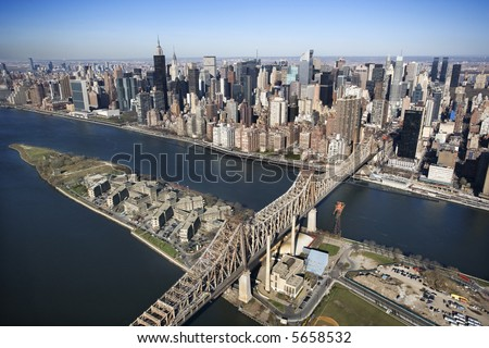 Aerial view of Queensboro Bridge in New York City with Rooseveldt Island and  Manhattan cityscape. - stock photo