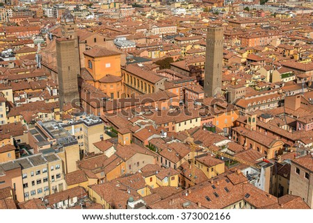 Aerial view of red tiled rooftops and ancient �?�«Due Torri�?�» towers in historical center of Bologna, Italy - stock photo