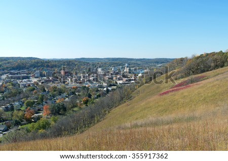aerial view of red wing minnesota framed by barn bluff and distant horizon against blue sky - stock photo
