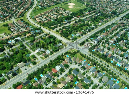 Aerial view of residential area in typical suburb home community in Ontario, Canada - stock photo