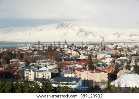 Aerial view of Reykjavik from Perlan, snow capped mountains during winter sunset, Iceland - stock photo