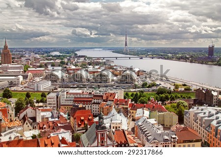 aerial view of Riga old town, city market and river Daugava - stock photo