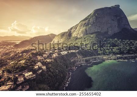Aerial view of Rio de Janeiro's Pedra da Gavea Mountain and tunel to Barra da Tijuca, Brazil - stock photo