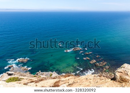 Aerial view of rocky ocean shore - stock photo