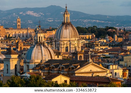 Aerial view of Rome, Italy. Domes of St. Agnes in Agony Church (Chiesa di Sant'Agnese in Agone) and Church of San Salvatore in Glory (Chiesa di san Salvatore in Lauro) against city background - stock photo