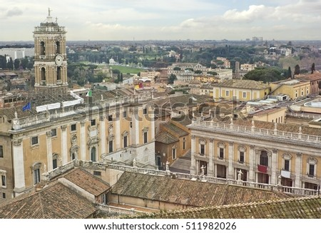 Aerial view of Rome with ancient roofs on the foreground