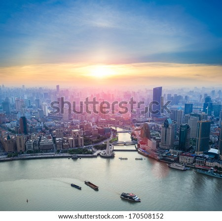aerial view of shanghai and  huangpu river at dusk  - stock photo
