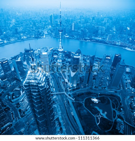 aerial view of shanghai at dusk with blue tone - stock photo