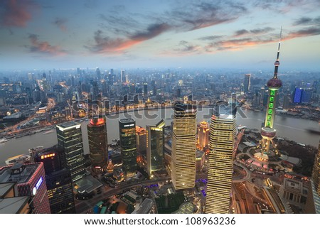aerial view of shanghai at evening with sunset glow - stock photo