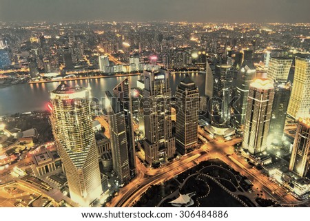 aerial view of shanghai at night from jinmao building - stock photo