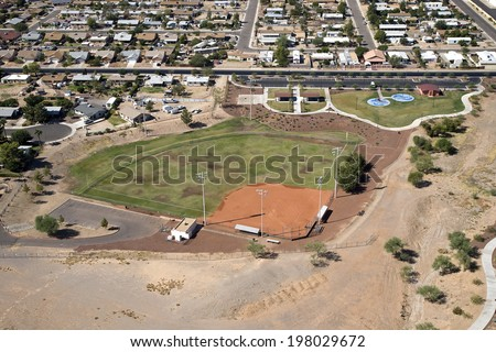 Aerial view of small neighborhood park with ball field and playground - stock photo