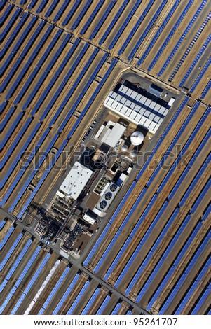 aerial view of solar parabolic power plant - stock photo