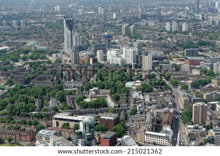 Aerial view of south London -  Elephant and Castle area (Newington) with the famous Strata building, one of the tallest residential   buildings in London,  and beyond. - stock photo