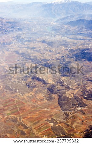 Aerial view of Spain with fields and mountains - stock photo