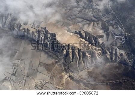 Aerial view of spanish mountains from hot air ballon - stock photo