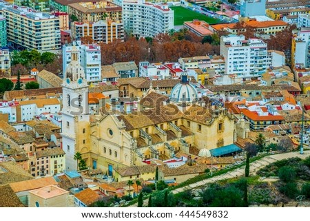 Aerial view of Spanish town Xativa with a principal church during a summer day in winter - stock photo