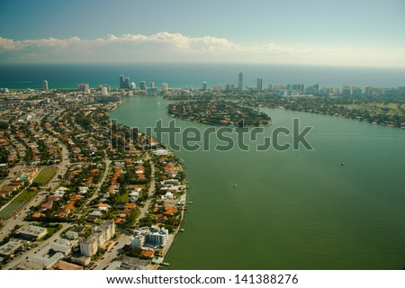 Aerial view of sprawling suburbs of Miami city waterfront, Florida, U.S.A. - stock photo