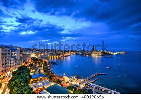 Aerial view of St. Julian's bay at the blue hour, Malta - stock photo