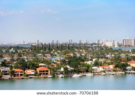 Aerial view of Star Island in foreground and Miami skyline in background - stock photo